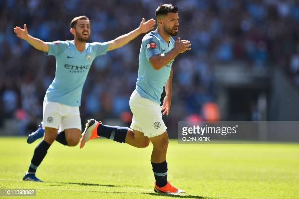 Manchester City's Argentinian striker Sergio Aguero celebrates with Manchester City's Portuguese midfielder Bernardo Silva after scoring the opening...