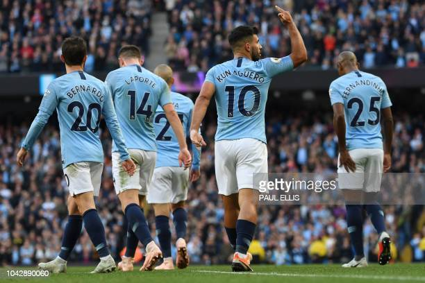 Manchester City's Argentinian striker Sergio Aguero celebrates with teammates after scoring the team's second goal during the English Premier League...