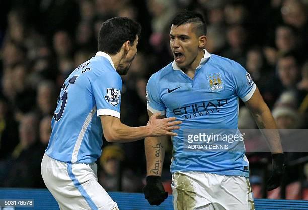 Manchester City's Argentinian striker Sergio Aguero celebrates with Manchester City's Spanish midfielder Jesus Navas after scoring their second goal...