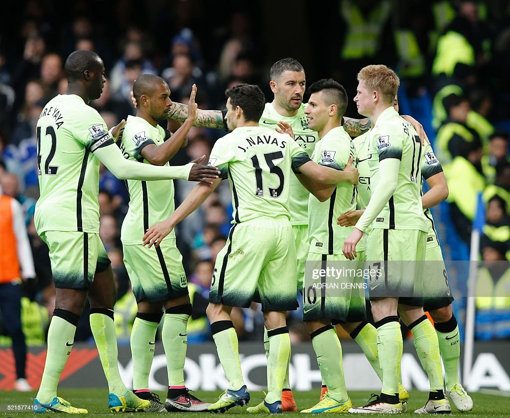 Manchester City's Argentinian striker Sergio Aguero (3rd R) celebrates with teammates after scoring their second goal during the English Premier League football match between Chelsea and Manchester City at Stamford Bridge in London on April 16, 2016. / AFP / Adrian DENNIS / RESTRICTED TO EDITORIAL USE. No use with unauthorized audio, video, data, fixture lists, club/league logos or 'live' services. Online in-match use limited to 75 images, no video emulation. No use in betting, games or single club/league/player publications. /