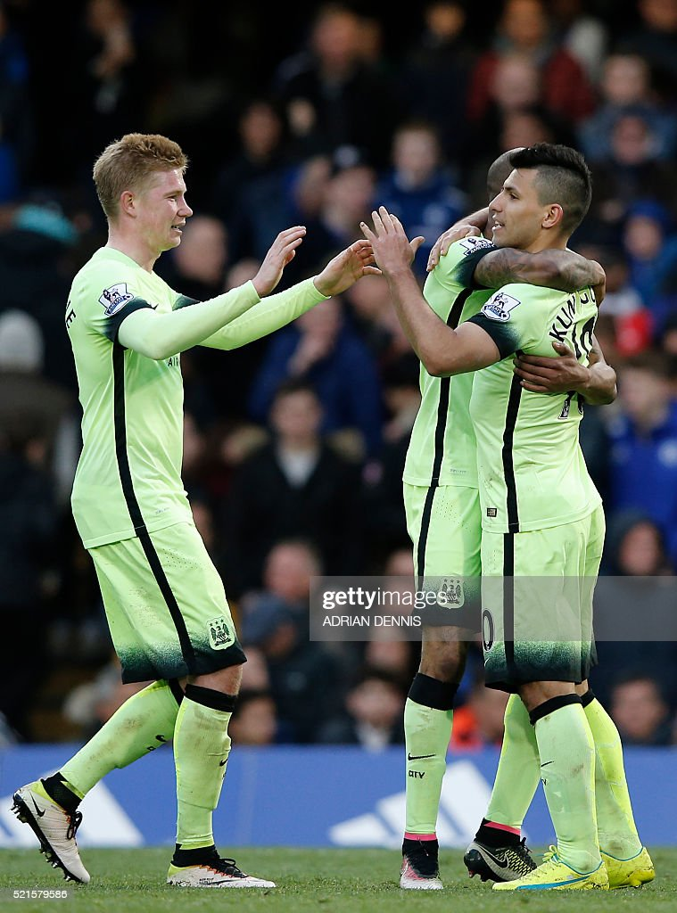 Manchester City's Argentinian striker Sergio Aguero (R) celebrates with teammates after scoring their third goal during the English Premier League football match between Chelsea and Manchester City at Stamford Bridge in London on April 16, 2016. / AFP / Adrian DENNIS / RESTRICTED TO EDITORIAL USE. No use with unauthorized audio, video, data, fixture lists, club/league logos or 'live' services. Online in-match use limited to 75 images, no video emulation. No use in betting, games or single club/league/player publications. /