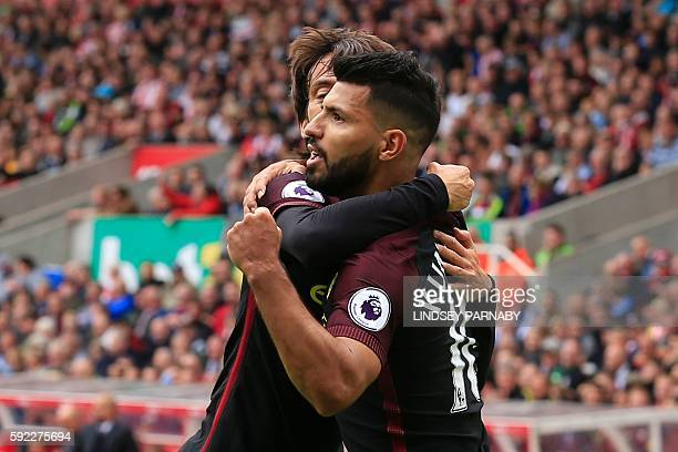Manchester City's Argentinian striker Sergio Aguero celebrates with Manchester City's Spanish midfielder David Silva after scoring the opening goal...