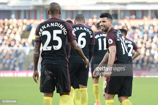 Manchester City's Argentinian striker Sergio Aguero celebrates with teammates after scoring their second goal during the English Premier League...