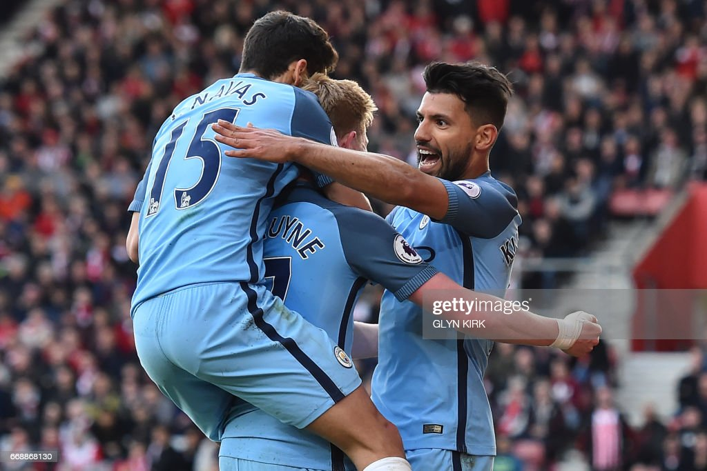 Manchester City's Argentinian striker Sergio Aguero (R) celebrates with teammates after scoring their third goal during the English Premier League football match between Southampton and Manchester City at St Mary's Stadium in Southampton, southern England on April 15, 2017. / AFP PHOTO / Glyn KIRK / RESTRICTED TO EDITORIAL USE. No use with unauthorized audio, video, data, fixture lists, club/league logos or 'live' services. Online in-match use limited to 75 images, no video emulation. No use in betting, games or single club/league/player publications. /