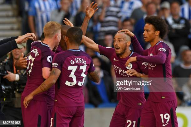 Manchester City's Argentinian striker Sergio Aguero celebrates with teammates after scoring the opening goal of the English Premier League football...