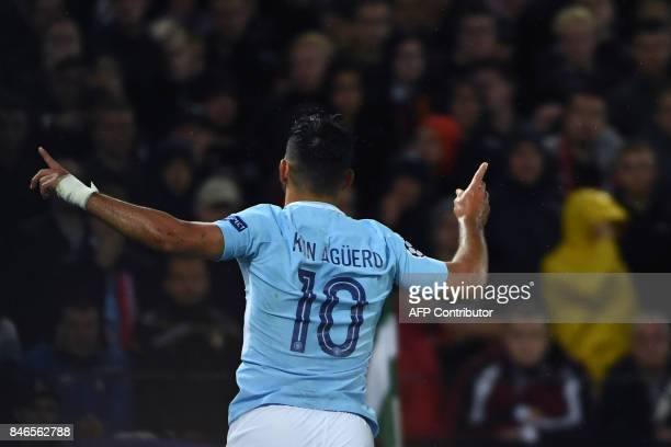 Manchester City's Argentinian striker Sergio Aguero celebrates with teammates after scoring a goal during the UEFA Champions League Group F football...