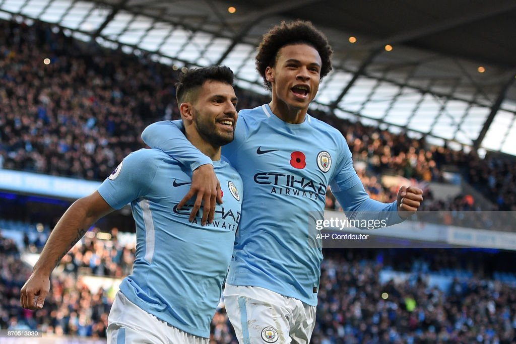 TOPSHOT - Manchester City's Argentinian striker Sergio Aguero (L) celebrates with Manchester City's German midfielder Leroy Sane (R) after scoring their second goal from the penalty spot during the English Premier League football match between Manchester City and Arsenal at the Etihad Stadium in Manchester, north west England, on November 5, 2017. / AFP PHOTO / Oli SCARFF / RESTRICTED TO EDITORIAL USE. No use with unauthorized audio, video, data, fixture lists, club/league logos or 'live' services. Online in-match use limited to 75 images, no video emulation. No use in betting, games or single club/league/player publications. /