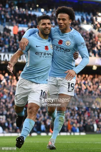 Manchester City's Argentinian striker Sergio Aguero celebrates with Manchester City's German midfielder Leroy Sane after scoring their second goal...