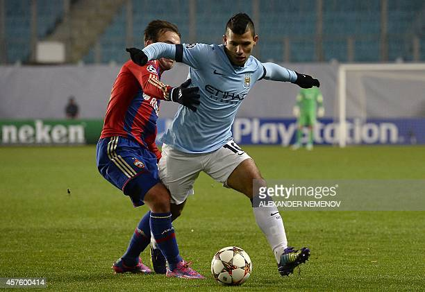 Manchester City's Argentinian striker Sergio Aguero challenges CSKA Moscow's Israeli midfielder Bebars Natcho during the UEFA Champions League group...