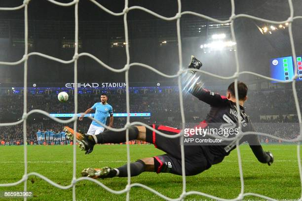 Manchester City's Argentinian striker Sergio Aguero chips the ball over Wolverhampton Wanderers' English goalkeeper Will Norris to score the winning...