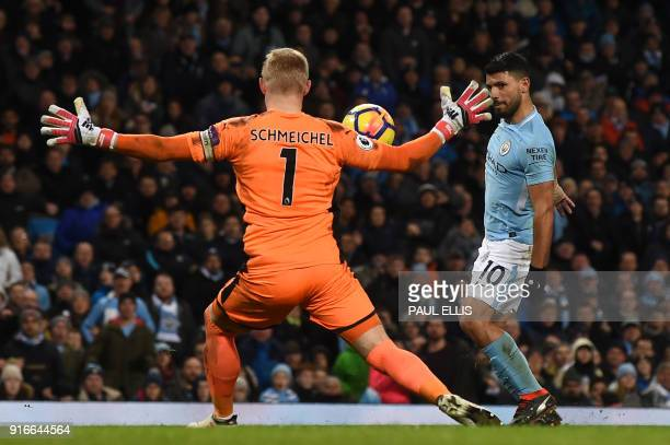 Manchester City's Argentinian striker Sergio Aguero chips the ball over Leicester City's Danish goalkeeper Kasper Schmeichel to score their fourth...