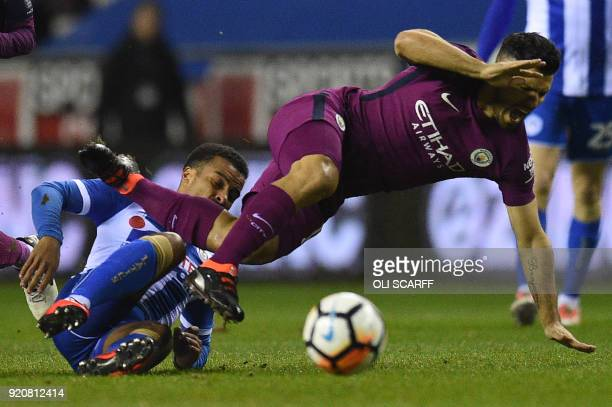 Manchester City's Argentinian striker Sergio Aguero clashes with Wigan Athletic's English defender Nathan Byrne during the English FA Cup fifth round...