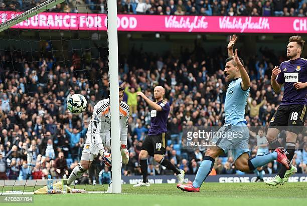 Manchester City's Argentinian striker Sergio Aguero follows up as the ball bounces into the goal after a big deflection off West Ham United's Welsh...