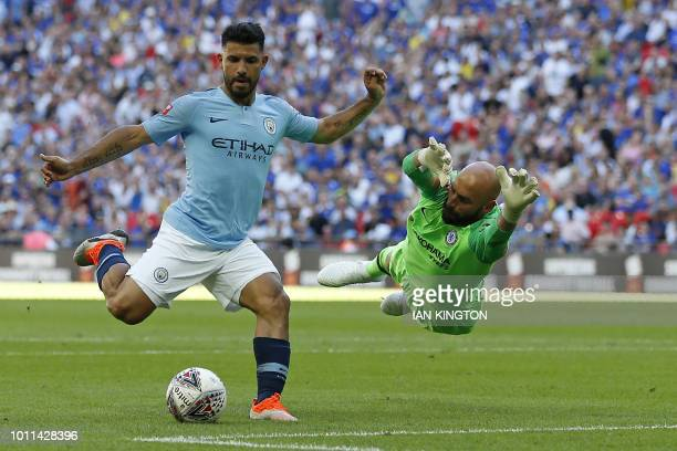 TOPSHOT Manchester City's Argentinian striker Sergio Aguero goes around Chelsea's Argentinian goalkeeper Willy Caballero but puts his shot wide...