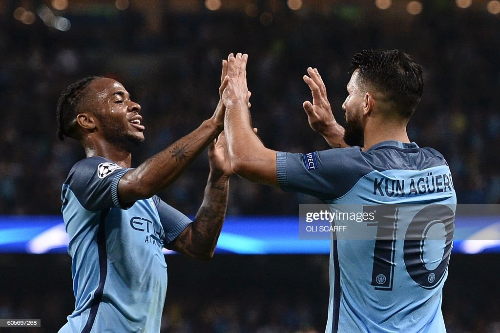 Manchester City's Argentinian striker Sergio Aguero (R) is congratulated by Manchester City's English midfielder Raheem Sterling (L) after scoring their third goal and completing his hattrick during the UEFA Champions League group C football match between Manchester City and Borussia Monchengladbach at the Etihad stadium in Manchester, northwest England, on September 14, 2016. / AFP / OLI