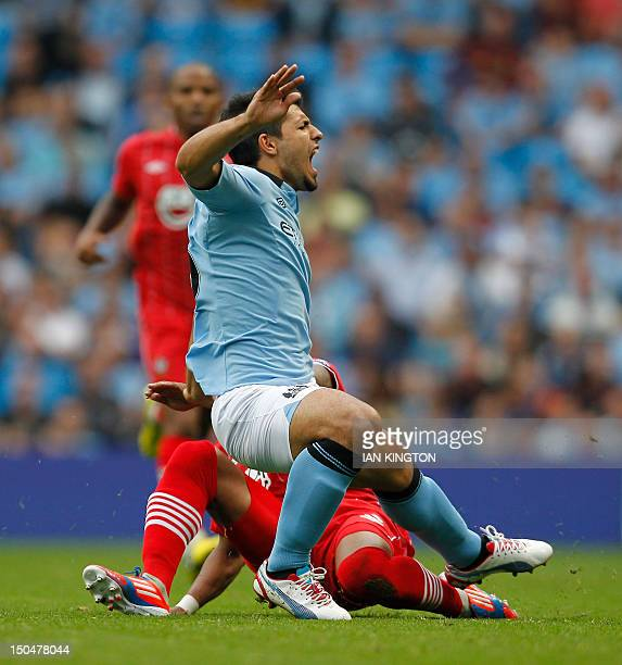 Manchester City's Argentinian striker Sergio Aguero is injured as Southampton's Nathaniel Clyne tackles him during the English Premier League...