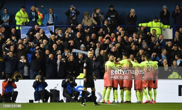 Manchester City's Argentinian striker Sergio Aguero is mobbed by teammates after scoring the opening goal during the English FA Cup fifth round...