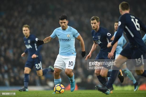 Manchester City's Argentinian striker Sergio Aguero is shadowed by Tottenham Hotspur's Belgian defender Jan Vertonghen during the English Premier...