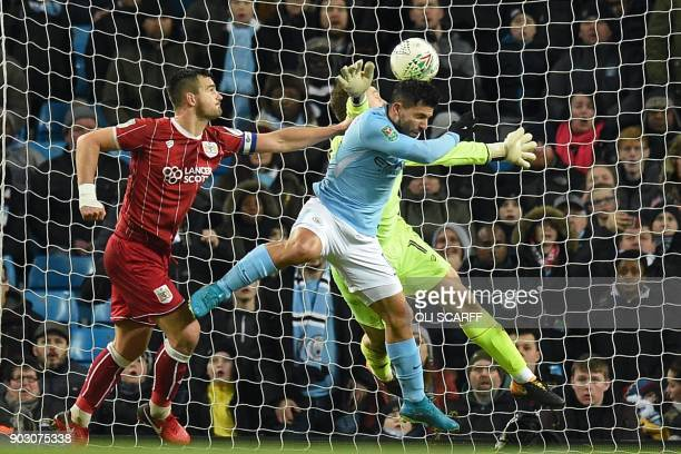 TOPSHOT Manchester City's Argentinian striker Sergio Aguero jumps to score their late winning goal during the English League Cup semifinal first leg...