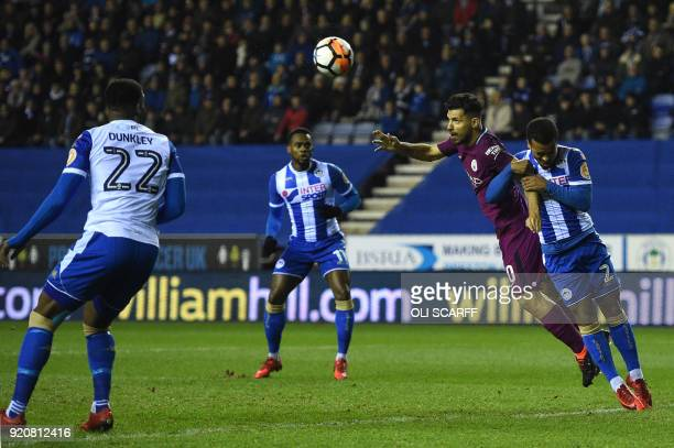 Manchester City's Argentinian striker Sergio Aguero misses a header at goal during the English FA Cup fifth round football match between Wigan...