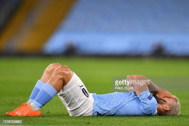 Manchester City's Argentinian striker Sergio Aguero reacts after picking up an injury during the UEFA Champions League football Group C match between...