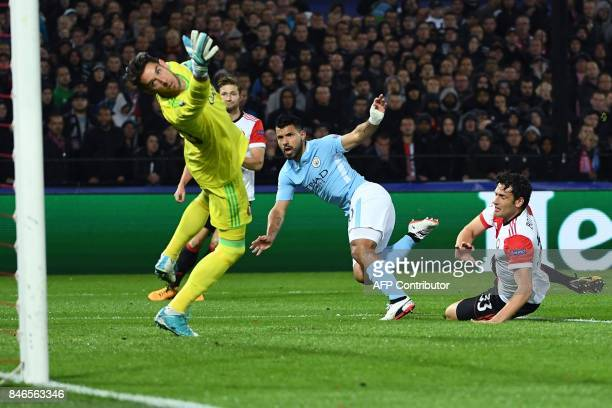 Manchester City's Argentinian striker Sergio Aguero reacts as he scores a goal during the UEFA Champions League Group F football match between...