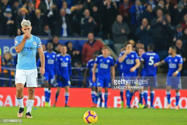 TOPSHOT Manchester City's Argentinian striker Sergio Aguero reacts as Leicester players celebrate scoring their second goal during the English...