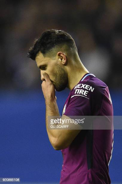 Manchester City's Argentinian striker Sergio Aguero reacts during the English FA Cup fifth round football match between Wigan Athletic and Manchester...