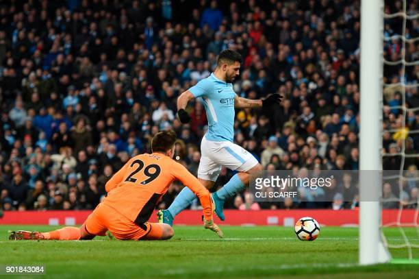 Manchester City's Argentinian striker Sergio Aguero rounds Burnley's English goalkeeper Nick Pope to score their second goal during the English FA...