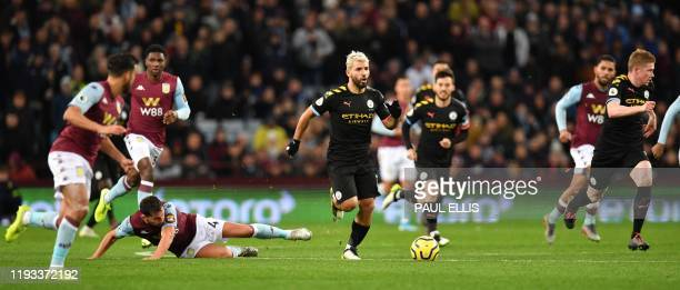 Manchester City's Argentinian striker Sergio Aguero runs with the ball during the English Premier League football match between Aston Villa and...