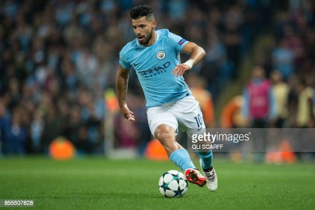 Manchester City's Argentinian striker Sergio Aguero runs with the ball during the Group F football match between Manchester City and Shakhtar Donetsk...