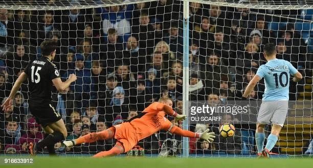 Manchester City's Argentinian striker Sergio Aguero scores past Leicester City's Danish goalkeeper Kasper Schmeichel during the English Premier...