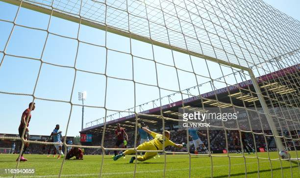 Manchester City's Argentinian striker Sergio Aguero scores the opening goal during the English Premier League football match between Bournemouth and...