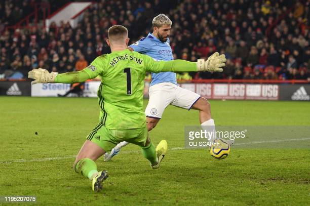 Manchester City's Argentinian striker Sergio Aguero scores the opening goal past Sheffield United's English goalkeeper Dean Henderson during the...