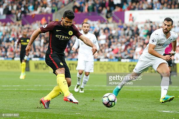 Manchester City's Argentinian striker Sergio Aguero scores the opening goal during the English Premier League football match between Swansea City and...