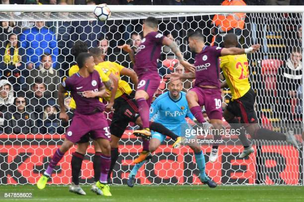 TOPSHOT Manchester City's Argentinian striker Sergio Aguero scores the team's first goal during the English Premier League football match between...