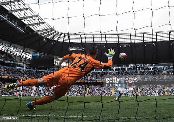 Manchester City's Argentinian striker Sergio Aguero scores their second goal past Stoke City's Irish goalkeeper Shay Given from the penalty spot...