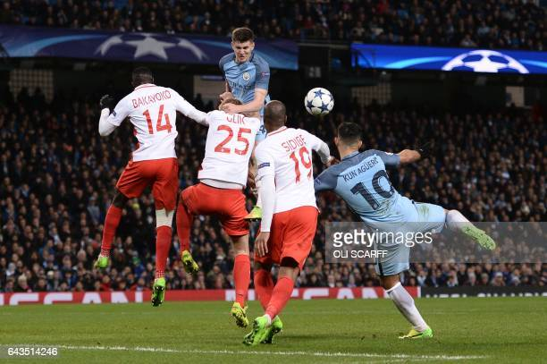 TOPSHOT Manchester City's Argentinian striker Sergio Aguero scores their third goal during the UEFA Champions League Round of 16 firstleg football...