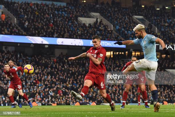 Manchester City's Argentinian striker Sergio Aguero shoots to score the opening goal of the English Premier League football match between Manchester...