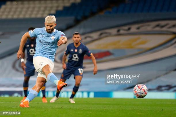 Manchester City's Argentinian striker Sergio Aguero shoots to score their first goal from the penalty spot to equalise 1-1 during the UEFA Champions...