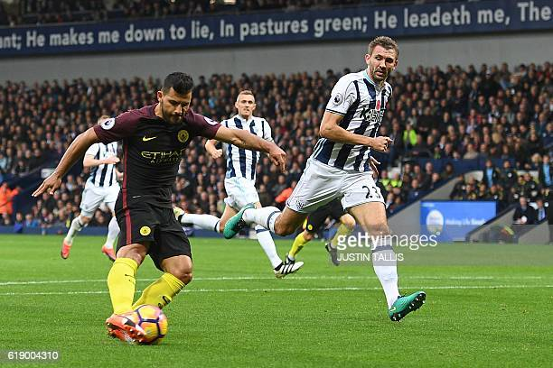 Manchester City's Argentinian striker Sergio Aguero shoots to score the opening goal of the English Premier League football match between West...