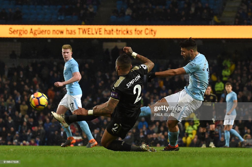 Manchester City's Argentinian striker Sergio Aguero (R) shoots to score their fifth goal, his fourth during the English Premier League football match between Manchester City and Leicester City at the Etihad Stadium in Manchester, north west England, on February 10, 2018. Manchester City won the game 5-1. / AFP PHOTO / PAUL ELLIS / RESTRICTED TO EDITORIAL USE. No use with unauthorized audio, video, data, fixture lists, club/league logos or 'live' services. Online in-match use limited to 75 images, no video emulation. No use in betting, games or single club/league/player publications. /