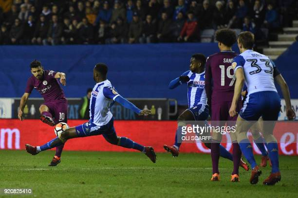 Manchester City's Argentinian striker Sergio Aguero shot at goal blocked during the English FA Cup fifth round football match between Wigan Athletic...