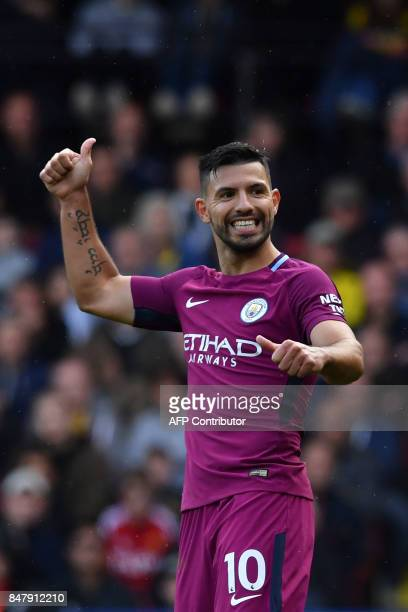 Manchester City's Argentinian striker Sergio Aguero signals a good pass to a teammate during the English Premier League football match between...