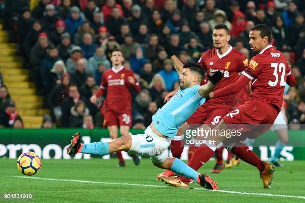 Manchester City's Argentinian striker Sergio Aguero stretches for the ball but can't make contact during the English Premier League football match...