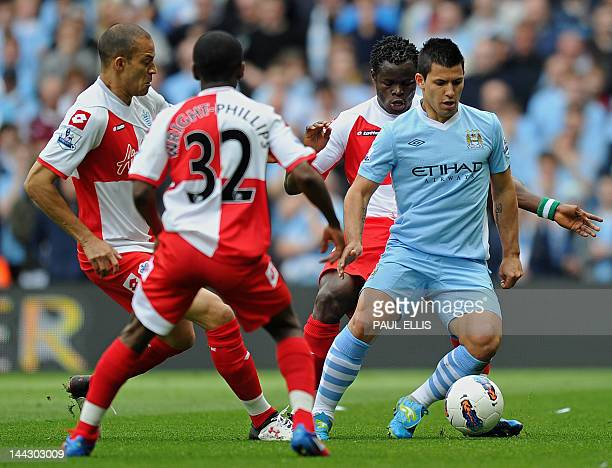 Manchester City's Argentinian striker Sergio Aguero surrounded by Queens Park Rangers players Taye Taiwo Shaun WrightPhillips and Bobby Zamora during...