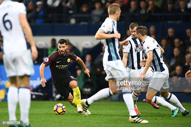 Manchester City's Argentinian striker Sergio Aguero takes on the West Brom defence during the English Premier League football match between West...