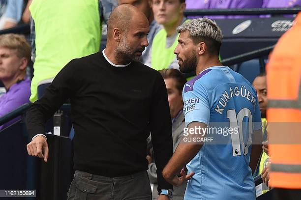 Manchester City's Argentinian striker Sergio Aguero talks with Manchester City's Spanish manager Pep Guardiola as he is substitued off during the...