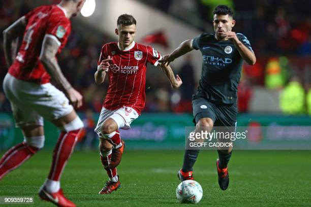 Manchester City's Argentinian striker Sergio Aguero vies with Bristol City's English midfielder Jamie Paterson during the English League Cup...