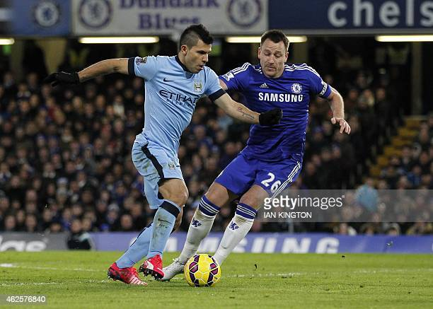 Manchester City's Argentinian striker Sergio Aguero vies with Chelseas English defender John Terry during the English Premier League football match...